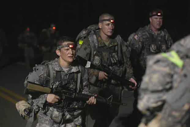 U.S. Army Soldiers conduct a 12-mile foot march during the Ranger Course on Fort Benning, GA., April 23, 2015. Soldiers attend the Ranger Course to learn additional skills in a physically demanding environment. (U.S. Army /Sgt. Paul Sale/Released)