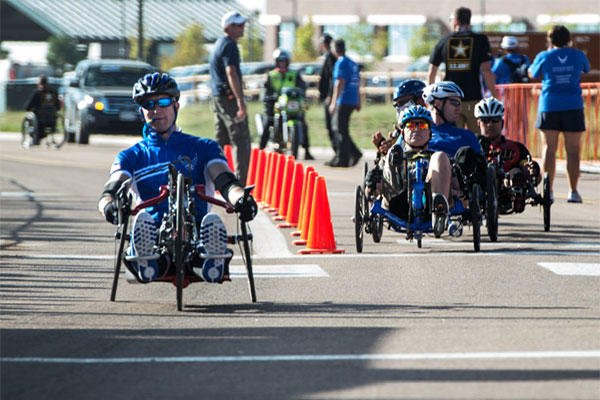 Former Senior Airman Jeremiah Means crosses the finish line at the Warrior Games hand-cycling event Sept. 29, 2014, at Fort Carson, Colo. He took 8th place in his category. Senior Airman Jette Carr/Air Force