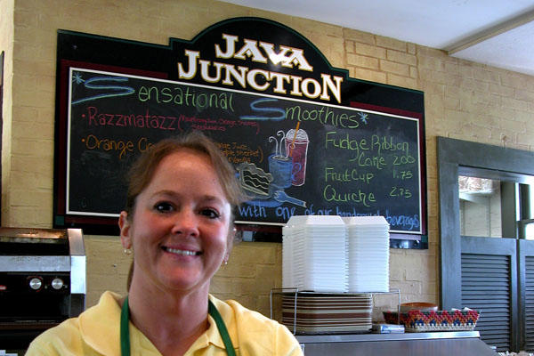 Lisa Rowe smiling at the Java Junction coffee shop she operates.