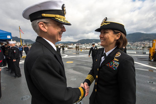 Capt. Kristy McCallum greets Rear Adm. Hugh Wetherald