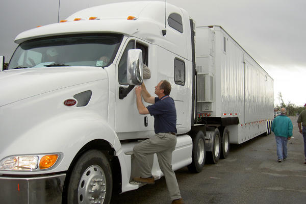 TRANSPORTATION JOBS CAREER ADVICE. Truckers Driving A White Semi