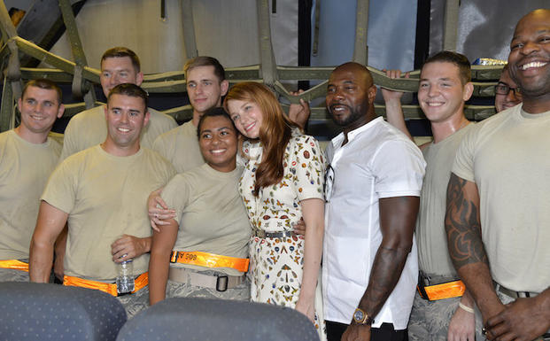 The Magnificent 7  movie actress Haley Bennett (center) hugs a service member as she joins director Antoine Fuqua (right) aboard a USAF KC-10 tanker during a tour prior to a USO-sponsored film premiere at Joint Base McGuire-Dix-Lakehurst, New Jersey, September 18, 2016. The cast members and director toured the flightline, greeted service members and met with military families to extend their appreciation for their service.             USO Photo by Mike Theiler