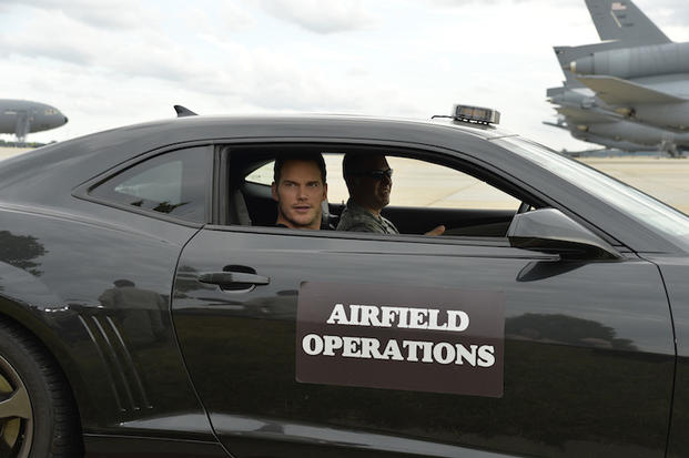 The Magnificent 7 movie actor Chris Pratt arrives on the flightline in a Camaro prior to a USO-sponsored film premiere at Joint Base McGuire-Dix-Lakehurst, New Jersey, September 18, 2016. The cast members and director toured the flightline, greeted service members and met with military families to extend their appreciation for their service. USO Photo by Mike Theiler
