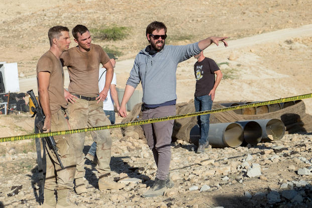Logan Marshall-Green, Nicholas Hoult and director Fernando Coimbra on the set of Sand Castle (photo courtesy Netflix).