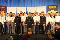 Gen. Mark Milley stands with audience members -- cadets, lieutenants and captains associated with the cyber force -- at the 2017 International Conference on Cyber Conflict U.S. (US Army/Steven Stover)