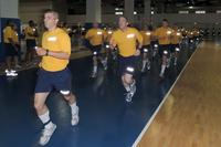 Recruits run during a physical fitness assessment in the Freedom Hall Physical Fitness Facility at Recruit Training Command, Great Lakes, Illinois. (U.S. Navy/Scott A. Thornbloom)