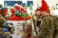 FILE -- Soldiers deployed to are served Christmas dinner from their command group at Bagram Airfield, Dec. 25, 2012. (U.S. Army/Staff Sgt. David J. Overson)
