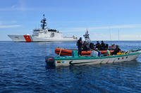 A boarding team aboard the Coast Guard Cutter Stratton apprehends four suspected drug smugglers in international waters in the drug transit zone of the Eastern Pacific Ocean, February 23, 2017. (U.S. Coast Guard photo/Mark Barney)