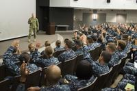 Rear Adm. John Wade, commander of Naval Surface and Mine Warfighting Development Center, speaks with students at the Surface Warfare Officer School Command's Basic Division Officer Course at Naval Base San Diego (U.S. Navy/Christopher E. Tucker)
