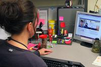 A military family member uses TRICARE online. (U.S Army/SPC Paxton Busch)