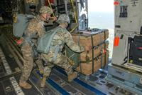 Paratroopers from the 82nd Airborne Division position the Caster Assisted A-Series Delivery System in the door of a U.S. Air Force C-17 aircraft before deployment onto Sicily Drop Zone on Fort Bragg, North Carolina. Photo: (U.S. Army)