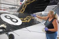 Shayne Meder touches up the tail of the HSC-8 show bird. (Photo: Daniel Langhorne)