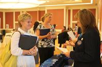 A military spouse speaks to a potential employer at the Marston Pavilion aboard Marine Corps Base Camp Lejeune during the Military Spouse Business Alliance Hiring Fair and Career Forum Aug. 9. (U.S. Marine Corps/Lance Cpl. Jackeline M. Perez Rivera)