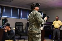 A 366th Training Squadron electrical systems apprentice course student at Sheppard Air Force Base, Texas, tests out a new medium of training, which involves virtual reality while digital designers James Rumfelt and Felton Joshua supervise the experience Jan. 26, 2018. (U.S. Air Force/Airman 1st Class Pedro Tenorio)