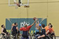 FILE -- An Air Force Wounded Warrior reaches for a rebound while playing wheelchair basketball practice to start February 13, 2018 at Baltimore County, Md. (U.S. Air Force/Staff Sgt. Alexandre Montes)