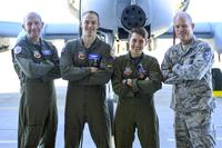 U.S. Air Force Gen. Mike Holmes, commander of Air Combat Command, Maj. Tyler Schultz and Capt. Samantha Harvey, 354th Fighter Squadron A-10C Thunderbolt II pilots, and Chief Master Sgt. Frank Batten III, command chief of ACC, pose for a photo at Davis-Monthan Air Force Base, Ariz., March 2, 2018. (U.S. Air Force/Airman 1st Class Giovanni Sims)