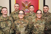 Pvts. Haley and Ashley Cook (front row); Pfc. Nicolette Bailey and her brother Pvt. James Dongarra; and Pvts. Andrew and Jacob Strength pose for pictures at the 16th Ordnance Battalion headquarters Nov. 16. The Soldiers -- the females are assigned to Alpha Company and the males to Charlie -- are all undergoing training in the Wheel Vehicle Mechanic Course at the Ordnance School. (U.S. Army/Terrance Bell)