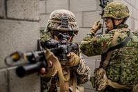 A U.S. Marine with 1st Combat Engineer Battalion and Japan Ground Self Defense Soldier with the Western Army Infantry Regiment, clear hallways while conducting Urban Explosive Demolitions training during exercise Iron Fist 2018, Jan. 19. (Robert Alejandre/Marine Corps)