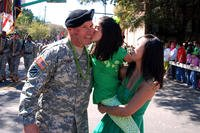 The 3rd Infantry Division's Command Sgt. Maj. Jeffrey Ashmen gets a kiss during the St. Patrick's Day parade in Savannah on March 17, 2011. (US Army photo/Monica Smith)