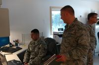Communication Airman, Staff Sgt. Samuel Camarista and Maj. Brett Ringger work together to ensure the electronic health care records systems are running during ARCTIC CARE 2017 between Kodiak Area Native Association and military IT systems to better support medical providers before seeing patients in Port Lions, Alaska, on March 29, 2017. (U.S. Air Force photo by Tech. Sgt. Wendy Day)