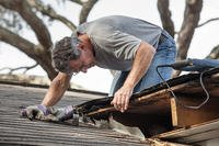 Man fixing a roof