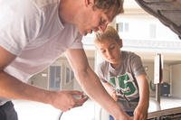Father and son working on a car
