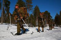 Marines and sailors with Marine Rotational Force-Europe 18.1 ski toward their next objective during a winter warfare training exercise at Haltdalen Training Center, Norway, on April 12, 2018. The Marine Corps is searching for a new ski system with universal bindings. Gunnery Sgt. Clinton Firstbrook/Marine Corps