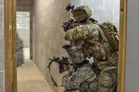Paratroopers assigned to Alpha Company, 1st Battalion, 508th Parachute Infantry Regiment provide security on a hallway during a nighttime air assault of a notional enemy compound at Fort A.P. Hill, Va., March 20, 2018. (U.S. Army photo/John Lytle)