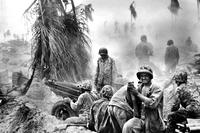 November 1943: U.S. Marines at the Battle of Tarawa in the Gilbert islands. Two Marines killed in that battle, which claimed the lives of 1,696 U.S. service members, were laid to rest on May 5. (US Marine Corps photo)