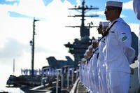 Sailors man the rails aboard the aircraft carrier USS Nimitz (CVN 68) as the ship prepares to moor at Joint Base Pearl Harbor-Hickam, Hawaii, Nov. 21, 2017. (U.S. Navy photo/Cole Schroeder)