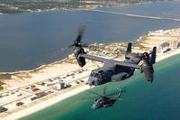 A CV-22 Osprey and an MH-53 fly over the coastline near Hurlburt Field, Fla. (U.S. Air Force photo/ Senior Airman Julianne Showalter)