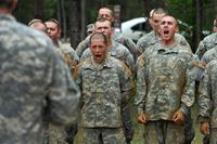 Army recruits in basic training deliver a call shortly after running an obstacle course on Fort Benning, Ga., May 4, 2012. (U.S. Army/Glenn Fawcett)