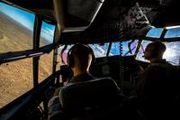 1st Lt. Eric Brown, left, and Capt. Brian Kursawe, KC130-J Hercules pilots with Marine Aerial Refueler Transport Squadron (VMGR) 152, conduct tactical navigation during unit-level training detachment El Centro Horizon at Naval Air Facility El Centro, Calif., Dec. 2, 2017. (U.S. Marine Corps/Cpl. Carlos Jimenez)