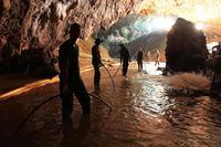 Thai rescue teams arrange a water pumping system at the entrance to a flooded cave complex where 12 boys and their soccer coach were trapped in northern Thailand. (Royal Thai Navy photo)