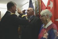William Gaschler, a retired Army veteran, accompanied by his wife, Karla Gaschler, exchanges a salute with Maj. Gen. Michael E. Kurilla during a Bronze Star Medal with Valor award presentation on Fort Bragg, N.C., July 28, 2018. (U.S. Army/Staff Sgt. Elvis Umanzor)