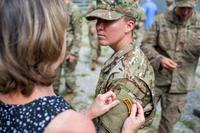 Staff Sgt. Amanda F. Kelley's family member pins on her Ranger tab during a graduation ceremony for Ranger Class 08-18 at Fort Benning, Ga., Aug. 31, 2018. (U.S. Army/Patrick A. Albright)