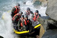 Students from Basic Underwater Demolition/SEAL class 281 participate in rock portage on Coronado Island. (U.S. Navy Photo by Mass Communication Specialist 2nd Class Kyle D. Gahlau)