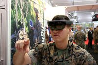 Marine Lance Corp. Nicholas Reedy, an artillery maintainer, demonstrates the Enhanced Maintenance Operations technology at Modern Day Marine 2018. The goggles equipped with augmented reality allow Marines to work on a 3-D model of an M777 155mm howitzer. (Military.com/Matthew Cox)