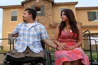 "Juan Dominguez and his wife, Alexis, hold hands during the unveiling of a ""smart home"" donated to him and his family here, Sept. 11, 2012. (U.S. Marine Corps/Jacob H. Harrer)"