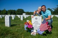 Alison Malachowski and former Marine Sgt. Danny Gonzalez hold each other at the grave marker of U.S. Marine Corps Staff Sgt. James Malachowski - Alison's son and Gonzalez's best friend and fellow Marine - in Section 60 of Arlington National Cemetery, July 22, 2015. (U.S. Army/Ken Scar)