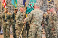 U.S. Army Maj. Gen. Andrew Poppas hands the Train, Advise and Assist Command-South colors to U.S. Army Brig. Gen. Jeffrey Smiley, incoming commander for TAAC-South, June 30, 2018 during a Transfer of Authority ceremony in Kandahar, Afghanistan. (U.S. Army photo/Neysa Canfield)