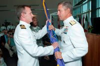 In a ceremony at the Joint and Coalition Warfighting complex in Suffolk, Va., Aug. 17, 2012, Rear Adm. Scott Stearney passes the Joint Public Affairs Support Element colors to the incoming commander, Capt. Jeffrey Breslau. (U.S. Navy photo/Marc Benshetler)