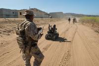 Pfc. Edgar Langle operates a newly developed Modular Advanced Armed Robotic System in a field environment at Marine Corps Base Camp Pendleton, Calif., July 8, 2016. (U.S. Marine Corps/ Lance Cpl. Julien Rodarte)