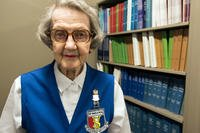 Helen Wells, a 94-year-old assistant library volunteer for the 59th Medical Wing, poses for a photo. (U.S. Air Force/Kevin Iinuma)