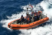 Coast Guard Cutter Bertholf crewmembers aboard a 26-foot Mark IV small boat approach the cutter during a counterdrug patrol in the Eastern Pacific Ocean, March 8, 2018. (U.S. Coast Guard/Petty Officer 1st Class Matthew S. Masaschi)