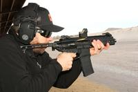 Sig Sauer's Patrick Hanley firing Sig's new newest version of the Rattler chambered in 5.56mm. (Military.com/Matthew Cox)