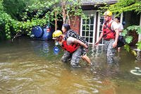 Woman being rescued from flood