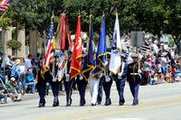 A joint services color guard leads off an annual Armed Forces Day parade (Photo: U.S. Air Force/Joe Juarez.)