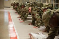 U.S. Army Trainees assigned to Foxtrot 1st Battalion 34th Infantry Regiment conduct push-ups for corrective training in the barracks on the first day of Basic Combat Training on June 12, 2017 at Fort Jackson, SC. (U.S. Army photo/Sgt. Philip McTaggart)