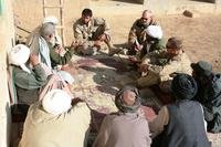 Capt. Jason C. Brezler, right, the team leader for 3rd Battalion, 4th Marine Regiment's civil affairs group, speaks with local elders in Now Zad, Afghanistan, Dec. 15, 2009. (Marine Corps Photo/Zachary Nola)